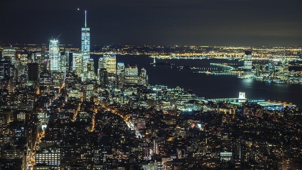 Thumbnail for USA, New York City, Manhattan Aerial Panorama Cityscape Skyline. Lights of the City at Night
