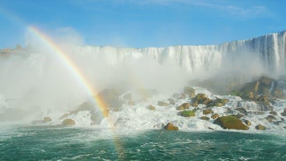 Thumbnail for Stunning Niagara Falls and a Rainbow. Bottom View. Falling Water Weight Raises