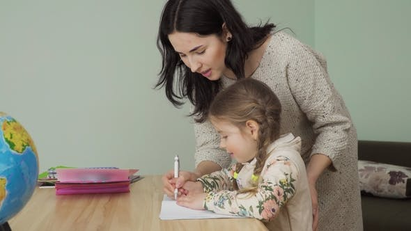 Thumbnail for Mother Help Little Girl To Write Correctly in Notebook