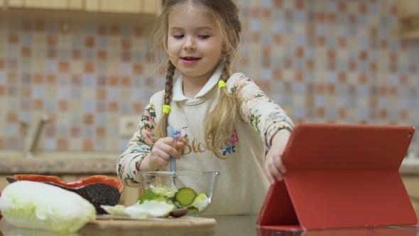 Thumbnail for Funny Little Girl Mixes Fresh Salad with a Spoon