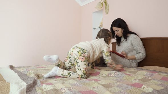 Thumbnail for Young Mother Asks Daughter Don't Disturb Her While She's Working