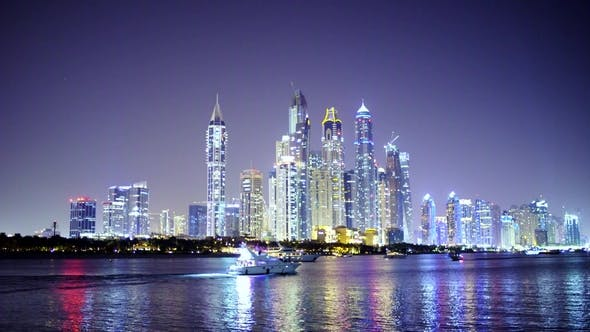 Thumbnail for Night Light Dubai Downtown with Floating Yachts and Boats in the Foreground