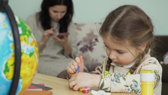 Thumbnail for Nice Little Girl Paints a Clay Craft Sitting at Table at Home