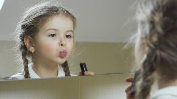 Thumbnail for Little Girl Paint Her Lips with Lipstick in Front of the Mirror