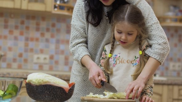 Thumbnail for Young Woman Teaches Her Daughter To Cut Cabbage for Salad
