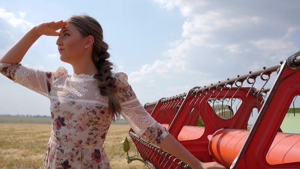 Thumbnail for Girl in Dress Waving Hand Hello in  Beside Agricultural Combine