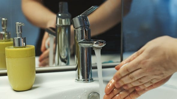 Thumbnail for Crop Man Washing Hands in Sink