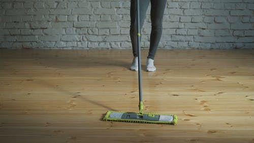 House Cleaning Washing of Wooden Floor