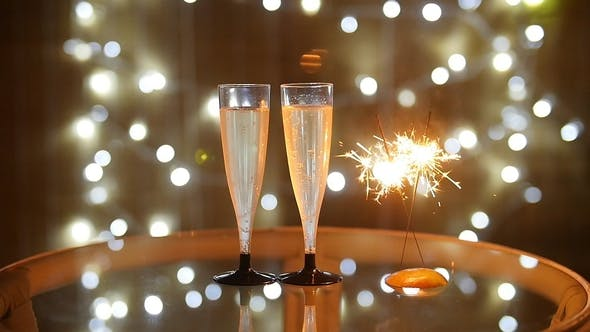Thumbnail for New Year Celebration with Two Champagne Glasses and Sparkler