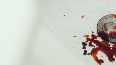 Panning Shot of Blood Pooling in Sink