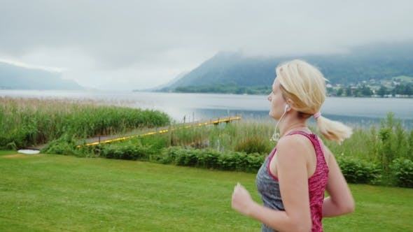 Thumbnail for Morning Jogging Near a Mountain Lake in the Alps. Steadicam Shot