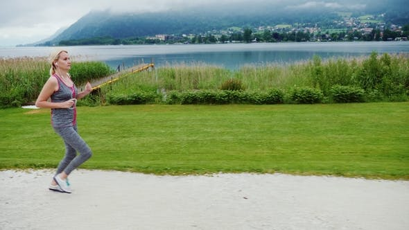 Thumbnail for Morning Jog in a Picturesque Place Amid the Alps Mountains Near a Beautiful Mountain Lake. Steadicam