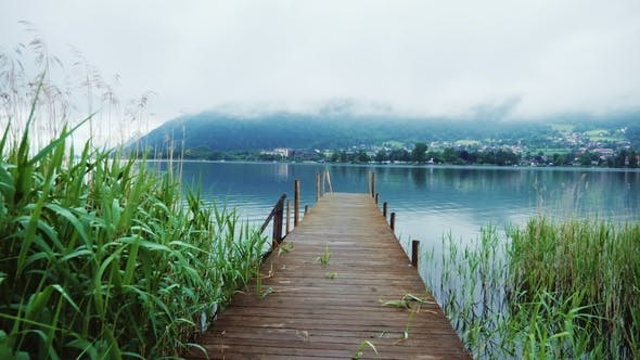 Thumbnail for Old Wooden Pier on a Picturesque Mountain Lake in the Alps in Austria