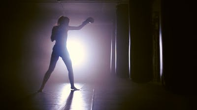 Woman Punches In Boxing Gym Shadow Boxing.