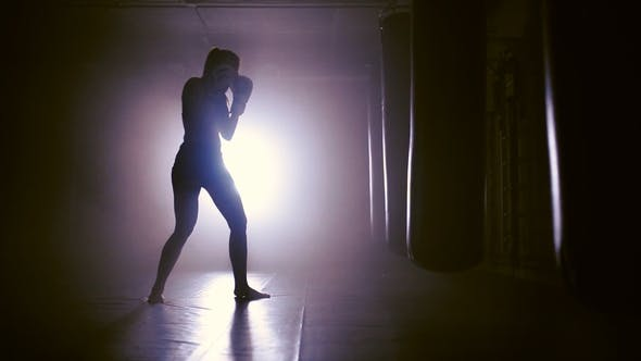 Thumbnail for Female Boxer Punches In Boxing Gym