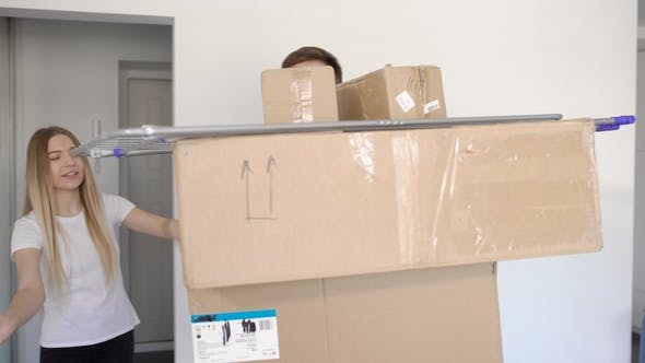 Thumbnail for Unrecognizable Man Standing with Luggage in Cardboard Boxes While Moving in with Girlfriend