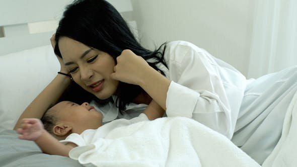 Thumbnail for Beautiful Asian Mother With A Baby 30