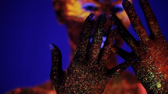 Thumbnail for Girl's Hands Glow in Ultraviolet Light