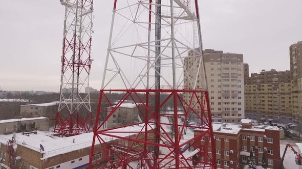 Aerial View on a Telecommunication Tower in a Winter Cloudy Daytime