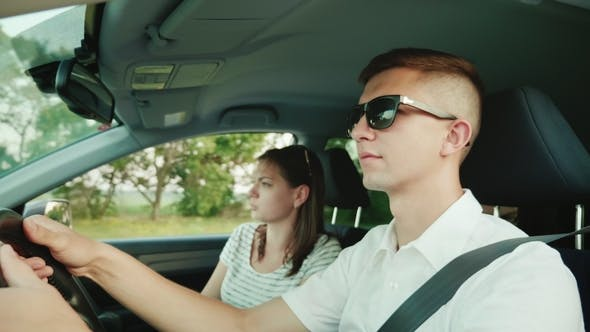 Thumbnail for A Young Couple Quarrels in the Car, Have an Unpleasant Conversation. Problems of a Young Family