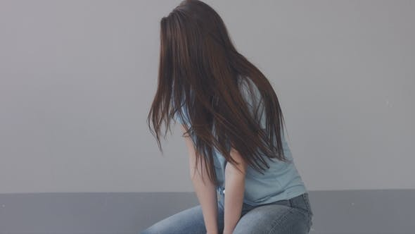Thumbnail for Caucasian Young Woman with Long Hair in Studio