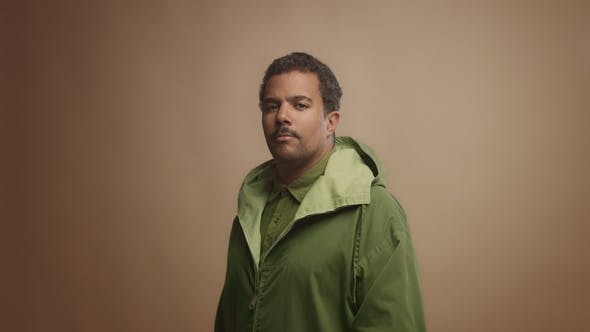 Thumbnail for Mixed Race Black Man on Beige Background in Studio Portrait