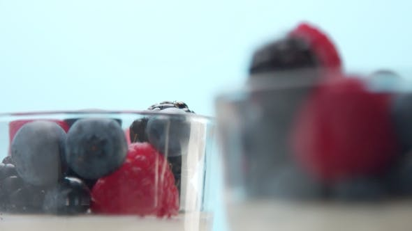 Thumbnail for Transparent Glasses Full of Yogurt, Panna Cotta, White Vanilla Mousse Decorated with Berries