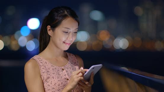 Thumbnail for Woman use mobile phone at night