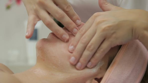 Thumbnail for Cosmetologist Does Facial Massage To Woman in Beauty Salon.