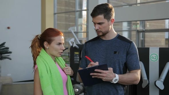 Thumbnail for Fitness Instructor Asks Woman Questions for Drawing Up an Optimal Program.