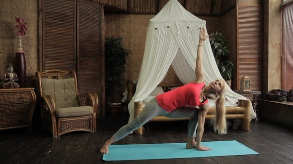 Thumbnail for Blond Lady Is Having Yoga Training in the Morning in Her Bedroom.