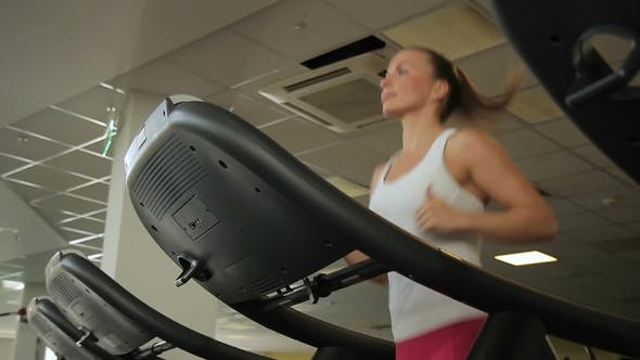 Thumbnail for Female Athlete Is Running on Treadmill in Gym