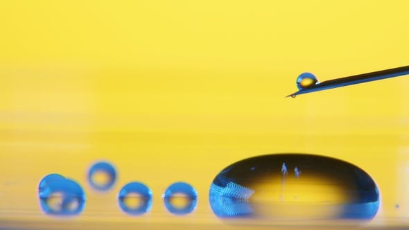 Thumbnail for Small Dribs of Water Fall From a Syringe and Roll Making a Small Pool