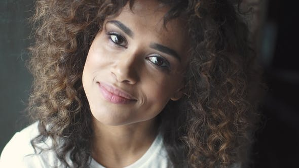 Thumbnail for Headshot Portrait of a Attractive Hispanic Girl with a Beautiful Smile. Mulatto Woman Smiles and