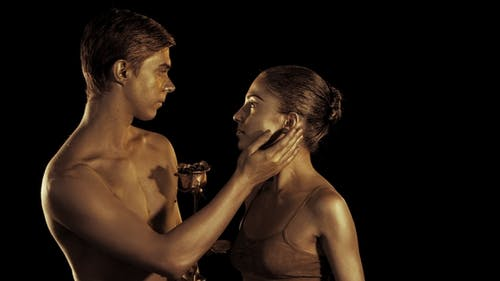 Professional Ballet Dancers on Dark Smoke Scene Performed By Sexual Couple with Golden Body Art
