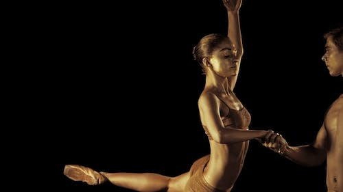 Professional, Emotional Ballet Dancers on Dark Scene Performed By Sexual Couple with Golden Body Art