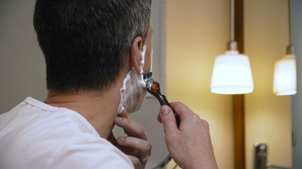 Thumbnail for Adult Man Shaving in Bathroom