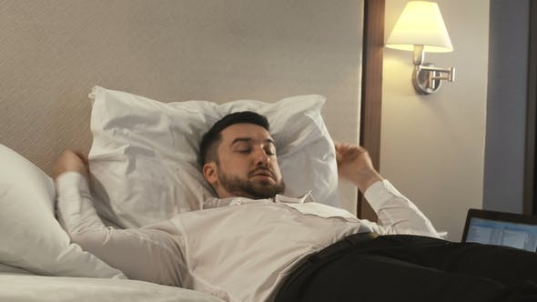 Thumbnail for Tired Businessman Taking Rest on Bed