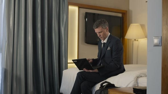 Thumbnail for Businessman Leaving Hotel Room with Suitcase