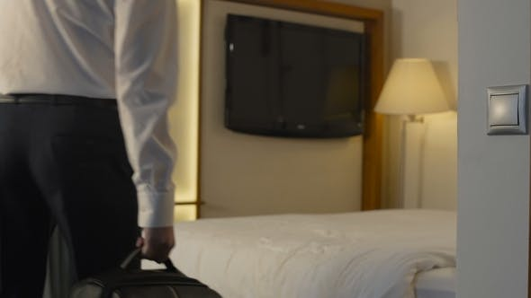 Thumbnail for Businessman Checking in Hotel Room During Trip