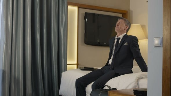 Thumbnail for Exhausted Businessman Falling on Bed in Hotel