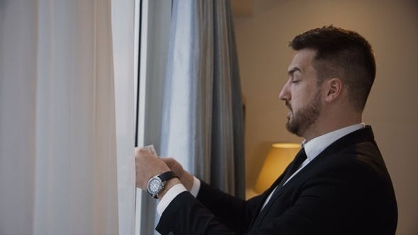 Thumbnail for Bearded Businessman Preparing Speech near Window