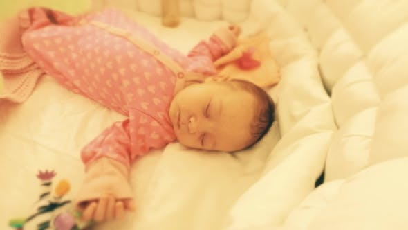 Thumbnail for Cute Newborn Baby Girl Sleeping in Her Cot