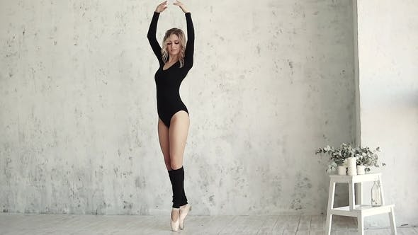 Thumbnail for Young Girl Dancer in Black Bodysuit and Gaiters. Ballerina in Pointe Shoes Danced on Tiptoe..