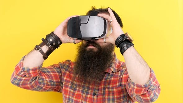 Thumbnail for Bearded Man Wearing a VR Virtual Reality Headset