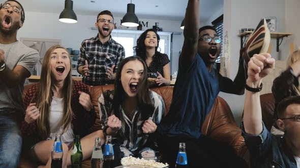 Thumbnail for Multi-ethnic Fans Go Crazy Celebrating Goal on TV. Passionate Football Supporters Scream with Arms