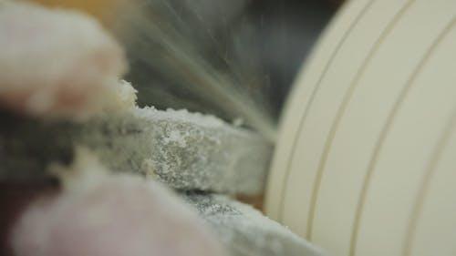 Man Working on Wood Lathe Using a Skew Chisel