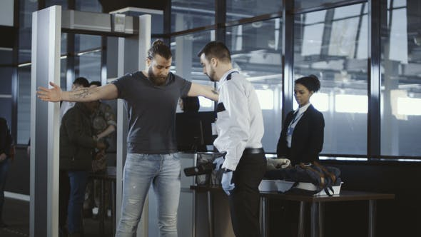 Thumbnail for Security Agent Patting Down a Male Passenger