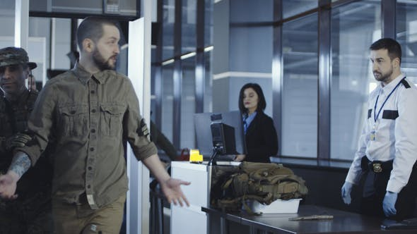 Man Transitting Weapon Standing in Airport