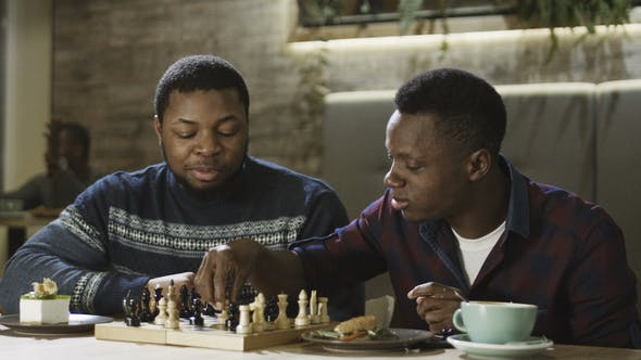 Thumbnail for Content Black Men Playing Chess in Cafeteria